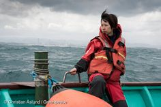29 Feb, 2016 Mai Suzuki, research and logistical coordinater from Greenpeace Japan, onboard Asakaze research vessel in front of Fukushima Daiichi nuclear plant, five years after the accident. The environmental organization has launched an underwater investigation into the marine impacts of radioactive contamination resulting from the 2011 nuclear disaster on the Pacific Ocean.