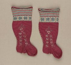 Pair of children's stockings        Italian, 1650–1750         Italy  Dimensions      23.1 x 11.9 cm (9 1/8 x 4 11/16 in. )  Medium or Technique      Cotton, silk, knit, embroidery    Accession Number      43.1962a-b