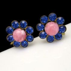BEAUTIFUL PINK ART GLASS! I love these earrings. The pretty pink art glass stones have swirls of color, and the deep blue rhinestones create a wonderful contrast! Vintage Earrings Pink Stones Blue Rhinestones Flowers Unique Design Beautiful, $29.95 from http://stores.ebay.com/My-Classic-Jewelry-Shop :)