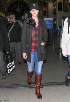 Going for comfort! The normally fashionable Lana Del Rey, 30, decided to dress down as she arrived at LAX on Sunday