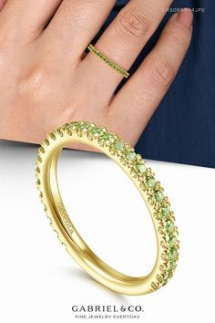 A timeless stackable ring with a sleek straight silhouette and dozens of vivid peridot gemstones. Crafted from luxe 14K yellow gold, this August birthstone ring effuses any ensemble with a pop of spring green color. LR50889Y4JPE #Stackable #DiamondStackable #StackableRings #PeridotStackableRing #YellowGoldRing Spring Green, Stackable Rings, Yellow Gold Rings, Peridot, Birthstones, Jewelery, Gemstone Rings, Gemstones, Diamond