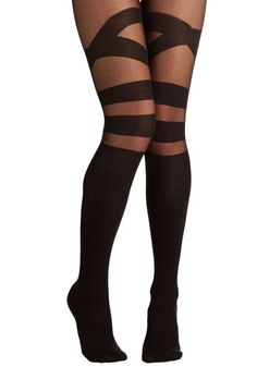 Strappy to Be Here Tights. You couldnt be more excited to clink glasses with the gals while wearing these sassy black tights. #black #modcloth