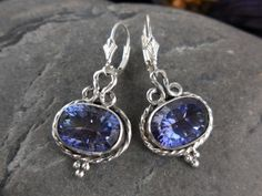 Made with 10x14mm oval mystic blue quartz gemstones, sterling silver bezel, wire, metal, and leverback earring wires.