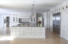 Kitchen #island in a #coastal style home with inviting color interiors