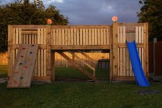 THIS IS AWESOME!!!! upcycled pallet playground...Papa can get pallets at work...a little boy wants a tree house. Hint hint. Grandma do you see this? Think they could build a tree house from pallets similar to this?