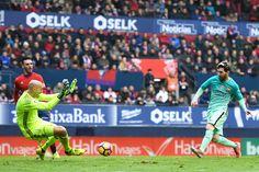 Lionel Messi of FC Barcelona shoots towards goal past Nauzet Perez of CA Osasuna during the La Liga match between CA Osasuna and FC Barcelona at Sadar stadium on December 10, 2016 in Pamplona, Spain.