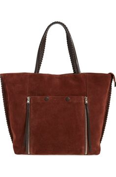 Lush suede and whipstitched leather trim play up the '70s-inspired vibe of a spacious around-town tote styled with tasseled zip gussets at the exterior front snap pocket.