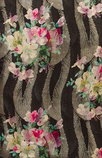 Deco lamé silk shawl, 1920s. The center panel of black satin damask is printed with colorful bouquets of lilies. The panel is set in a double layer border of black silk chiffon. The woven damask pattern is brocaded with silvery bronze metallic fibers. The exuberant Art Deco design is a celebration of color and graphic design. Here we see the influence of Fauvism (1905-1907), where vivid colors and simple flattened shapes were the dominant motifs.