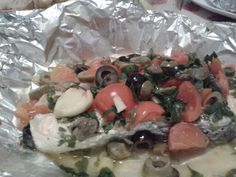 Salmone al cartoccio con olive pomodorini capperi....