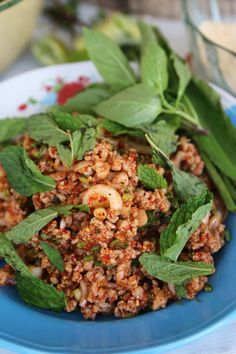 Larb Moo (Thai spicy mince pork)  In Thailand, larb moo (ลาบหมู) is normally eaten along with a plate of Thai sticky rice and accompanied by a plate of som tam (green papaya salad ส้มตำ).