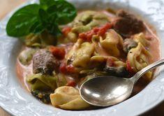 CREAMY TOMATO SPINACH CROCKPOT TORTELLINI WITH ITALIAN SAUSAGE