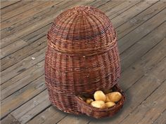 Wicker basket for potato and other vegetable storage. Also known as a potato hopper. It has a lid and provides the perfect amount of ventilation to keep it's contents in perfect condition. #WickerBasket