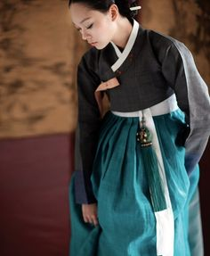 Stunning black hanbok that explicitly demonstrates restrained beauty and style. With teal color skirt and norigae (charm that goes with skirt), it is even more stylish! - Hanbok is a Korean. Korean Traditional Dress, Traditional Fashion, Traditional Dresses, Korean Dress, Korean Outfits, Modern Hanbok, Culture Clothing, Japanese Kimono, Textiles