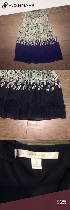 Lauren Conrand summer dress Perfect summer dress! LC has a wonderful collection and this baby has a flowery print and beatiful detail at the bottom. It is strapless and rests about 2 inches con the knee. LC Lauren Conrad Dresses Strapless