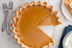 Homemade Pumpkin Pie made with simple ingredients that makes for a nostalgic holiday favorite.  Elevate this classic dessert with a homemade pie crust and top it with a dollop of homemade whipped cream! Pumpkin Pie is a must-have for our Thanksgiving dessert table.  In fact, it used to be my husband's favorite before he discovered … Frozen Pumpkin, Homemade Pumpkin Pie, Homemade Pie Crusts, Pumpkin Pie Recipes, Canned Pumpkin, Pumpkin Pie Spice, Homemade Whipped Cream, Classic Desserts, Butter Pie