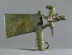 Ornamental bronze hatchet with rider figure.  Hallstatt period, 7th-century B.C.