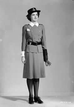 RCAF Nursing Sister, dark uniform, 18 Dec 1943.  (Library and Archives Canada Photo, MIKAN No. 3583106)
