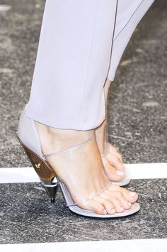 I realize this is not a shoe model, but holy shit, hammertoes?  Or is she just flexing them to keep her feet in the things?  [Givenchy, Spring 2013]