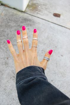 hot pink nails and rings