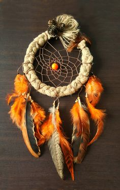 Handmade dream catcher- Unique rustic natural dream catcher is an amazing choice for your bedroom. It is very charming, as warm colors gives the dream catcher cozy feel. They are made out of fabric linen, thread, feathers, beads and cones THE SET INCLUDES: 1 Dream catcher as shown