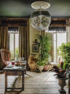 Obsessed with this boho London townhouse. Rattan, disco balls, peacock chairs and jungalow style galore.
