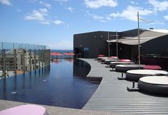 The heated rooftop pool from the Vine Hotel in Funchal, Portugal is considered one of The Best 18 Rooftop Pools From Around The Globe according to Homedit.com - January 2015   world-amazing-rooftop-pool-vine-hotel