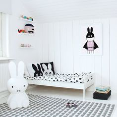 Here is a modern monochrome kids room with little splashes of colour. The vibe is very much of a black and white room but that poster and the toys bring in just the right hint of colour to make the room a bit more playful.