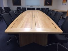 Product # MBW-17-Rutgers >>> Boat shaped hard rock maple conference room table with a full black walnut inlay. Built by Specialty Woods