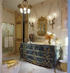 repurposed Bombe' commode chest as elegant bath vanity sink