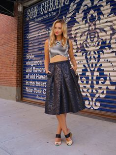 The elegance of this skirt is paired well w/ a black and white striped crop top & is accessorized with a great statement necklace and shoes we love.