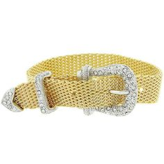 Bracelets White Gold Rhodium and 14k Gold Bonded 9 Inch Belt Buckle with Clear Cubic Zirconia Accents in Tutone. Our Golden Buckle Bracelet features a belt buckle design accented by shimmering clear crystals and light goldtone mesh. Cute and trendy this piece will be adored by all ages. 14k Bonded Gold is achieved using an electroplating process that coats the item with heavy layers of 18k Yellow Gold and color-treated to a perfect 14k Hamilton gold color. White Gold Rhodium Bond is achieved…