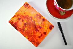 This Japanese stab bound notepad contains 40 pages (80 sides) of thick, white, unlined 140gsm cartridge paper, suitable for all media. Hand-painted, handcrafted and completely unique this notepad is perfect for jotting down and sketching out your ideas.