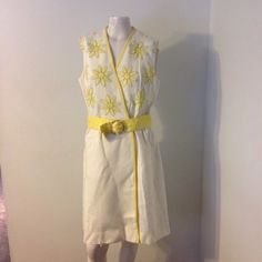"Vintage Yellow Flower Wrap Dress ML Beautiful vintage 60s dress! Wraps over and snaps on the inside waist and is belted. Fabric seems to be linen blend. Great condition. Chest 38"" Waist 32""-33"" Hips 43"" Snap can be moved to make this bigger or smaller. Vintage Dresses"
