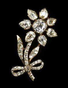 Catherine II diamond flower brooch. Silver and diamond flower jewel, tied with a ribbon. Provenance: Russian State Jewels. One of five sold Christie's 16 March, 1927, lots 36, 37.