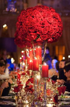 Dramatic red roses are the focal point of this deep hued wedding décor. Wedding Centerpieces, Flowers, Floral Arrangements, Candelabra, Pomander