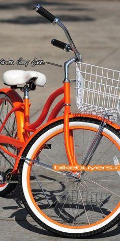 cool orange cruiser bike with a basket!