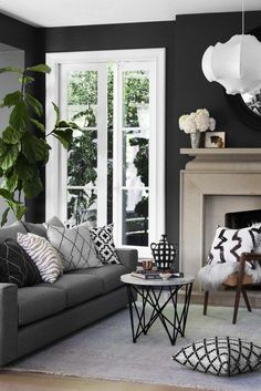 From formal to casual, and modern to classic, these grey living room ideas will satisfy every style of decorator.  #GreyLivingRoom #LivingRoom #DarkLivingRoom Dark Walls Living Room, Living Room Color Schemes, Living Room Pillows, Living Room Paint, Living Room Designs, Dark Rooms, Living Room No Tv, Living Room Decor With Grey Couch, Dark Grey Couches