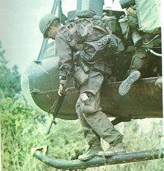 Stepping off a Huey rail. ~ Vietnam War