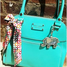 Oh, you know, just Kate Spade in turquoise with an elephant charm.  Swoon worthy