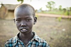 A young South Sudanese boy who is a refugee in a camp housing thousands who have fled the war in the neighbouring country.