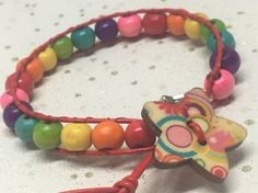 Rainbow bead and red leather bracelet Wrap Bracelets, Beaded Bracelets, Leather Cord, Red Leather, Wooden Stars, Organza Gift Bags, Silver Stars, Star Shape, Rainbow Colors