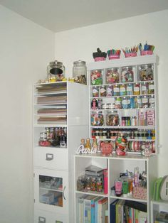 I love the white shelves with the clear glass jars. This brings the focus to the colors of the craft supplies.