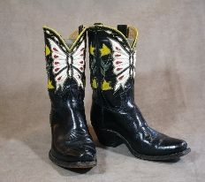 My, my a cowgirl can get fancy! Gorgeous butterfly and flower pattern on these ladies boots. SOLD from Cayuse in Jackson, Wyoming