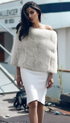 Glamourous: Jessica looks every inch the supermodel in her dramatic fur top and white skirt which contrasted beautifully with her dark hair