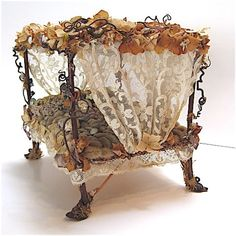 Whimsical Twig Art Bed. My granddaughters would love this for their dolls.