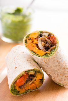 This roasted sweet potato recipe wraps your favorite sweet and salty into, well, a wrap! Paired with caramelized onions and pesto, this roasted sweet potato wrap will be a perfect meal to take for lunch for you or even the kids. Make Ahead Freezer Meals, Make Ahead Lunches, Work Lunches, Healthy Lunches, Healthy Eating, Freezer Recipes, Freezable Recipes, Healthy Food, Lunch Foods