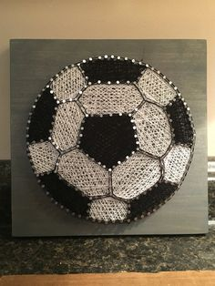MADE TO ORDER: Soccer ball String Art. Stained wood, silver wire nails, and black and white crochet thread. Sawtooth hanger included on back. *if you would prefer the wood to be painted in a color, please select painted in list and include color of painted in a message.