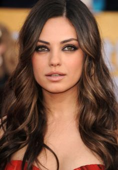 I like the dark brown hair with caramel highlights underneath. Hair ideas :)