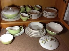 """SPLIT OUT INTO PERFECT ONES IN CUPBOARD, CRACKLED GLAZE ONES AND CRACKED TUREEN ON FLOOR. There are: Plates - 6 x 10"""" (1), 6 x 9"""" (1), 6 x 7.75"""" (2), Teacups Green & Gold - 6 x 3.75"""" across, Saucers - 6 x 5.5"""", Bowls 6 x 7.25"""" (1), Gravy Boat Green & Gold - 1 x 6"""" by 3"""" (1) with oval rest - 1 x 8.5"""" by 5.75"""" (1), Sugar Bowl Green & Gold - 1 x 4.75"""" (1) and Creamer Jug - 1 x 4"""".  Finally, Tureens - 2 x 7.75"""". One tureen has a crack inside (inside near handle about 2"""") & glaze has crackled on…"""