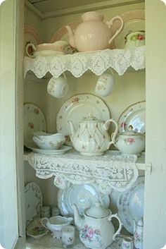 very nice... Oh how I want shelves like this with pretty china when i finally get a home!